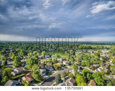 FORT COLLINS, CO, USA - MAY 23, 2016: Storm cloud over city of Fort Collins in northern Colorado - aerial view of springtime scenery.