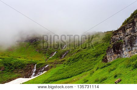 Landscape scenic with waterfall in Glacier National Park Montana. Going to the Sun road.