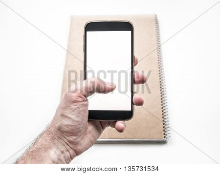 Hand holding and using mobile smartphone mockup