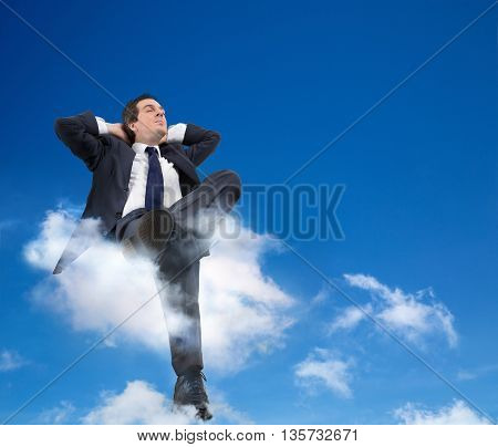 man relaxing on a cloud with head in the clouds