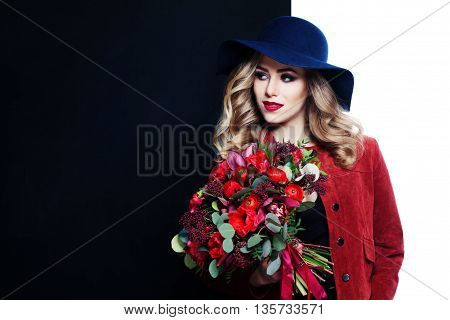 Pretty Model Holding Flowers Bouquet on Black and White Background