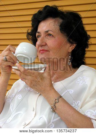 mature lady drinking coffee