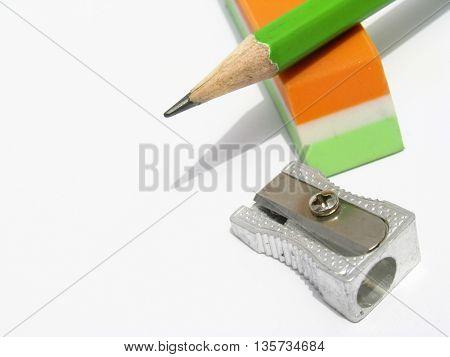 closeup of sharpener,eraser  and green pencil