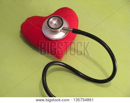 stethoscope on red heart shape