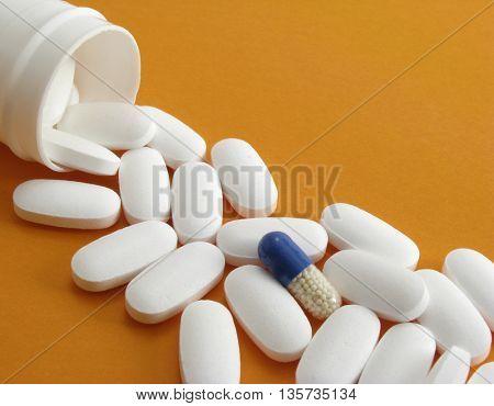 pills on orange background