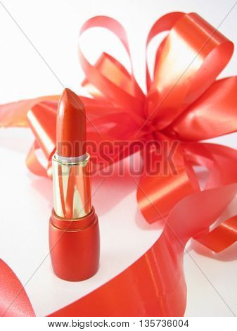 red lipstick and ribbon