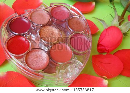 make up and red rose