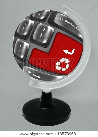 Recycle symbol button on keyboard placed on the globe