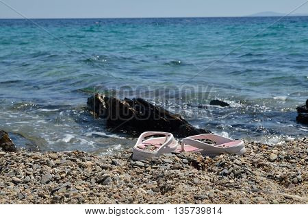 Flip-flops Left On Beach