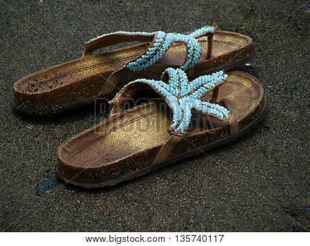 Sand and sea and slippers