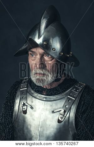 Portrait Of Knight With Gray Beard In Armor.