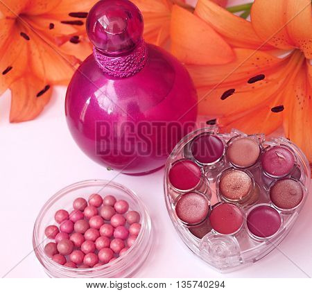 Perfume and makeup with flower