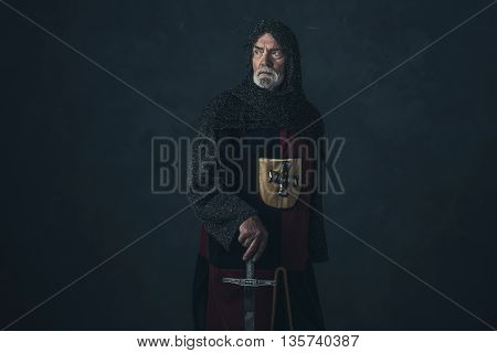 Knight With Beard In Hauberk Holding Sword.