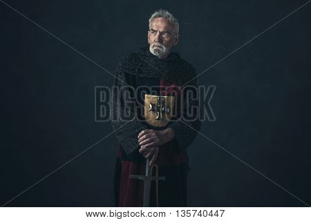 Senior Knight In Hauberk Standing With Sword.