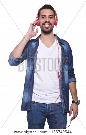 Portrait of young latin man listening to music. Isolated white background.