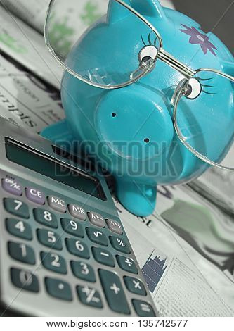 News,calculator, coffee,piggy bank and glasses-business concept
