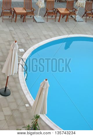 beautiful swimming pool surrounded by chairs