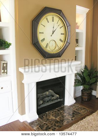 A photo of a contemporary fireplace, mantle, and clock
