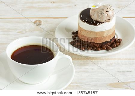 cup of coffee and cake on the table close-up