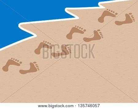 footprints on sand beach along the edge of sea