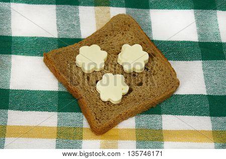 Sliced bread with butter in flower shape