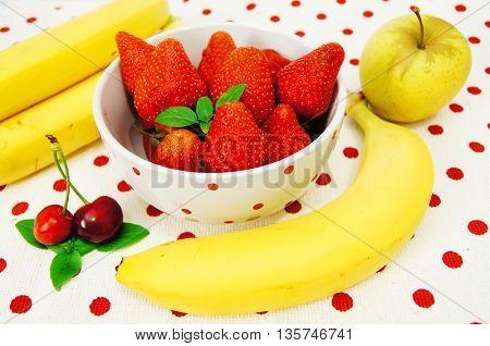 Beautiful strawberries ,apple,bananas and cherry