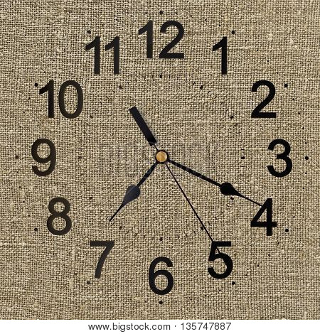 rustic clock on linen canvas fabric for background