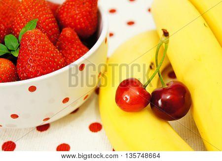Beautiful strawberries ,bananas and cherry