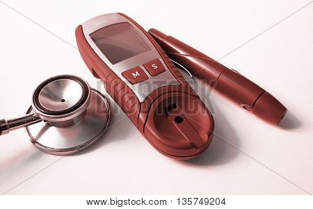 Stethoscope and device for measuring blood sugar level and isolated on white background