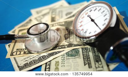 Blood pressure device and stethoscope  with money - high costs of expensive medication concept