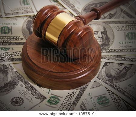 A photo of a gavel with a bribe theme