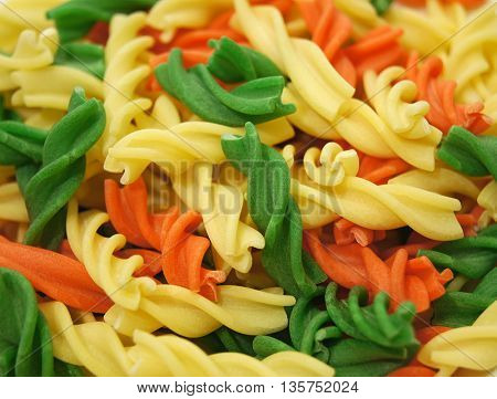 raw different colored pasta