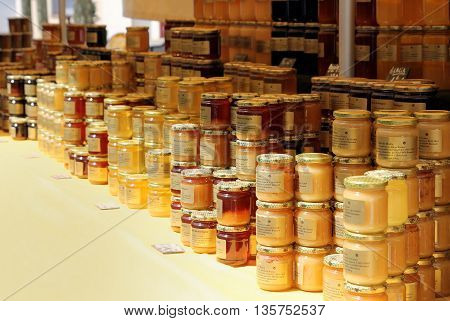 GRIMAUD PROVENCE FRANCE - JUNE 20 2016: Selection of hand made honey on a French market stall