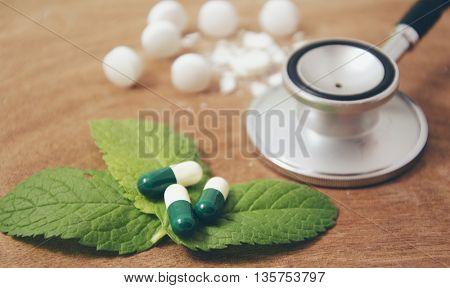 stethoscope and  pills