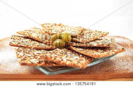 Integral biscuits plates with sesame and flax and green olive