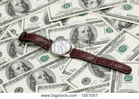 Hand Watch Over The Hundred Dollar Bank Notes