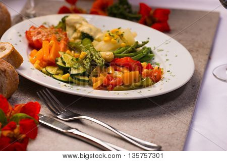 Vegetable plate with stewed with tomatoes peppers asparagus and vegetables Another