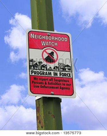 A photo of a neighborhood watch sign