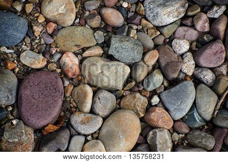 Small smooth colored stones on the ground