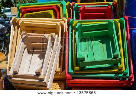 Dozens of Colorful wooden crates on the street