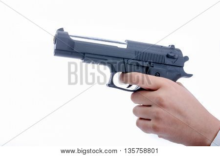 hand holding and pointing a toy gun on white background