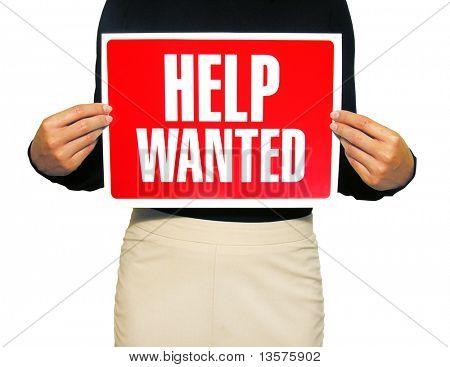 Una foto de una mujer de negocios con un cartel de ayuda querido