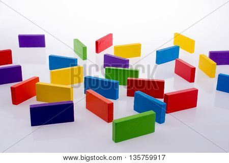 Some colored dominoes on a white background