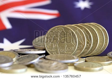 Australian dollars against background of Australian flag.