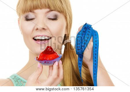 Woman Holds Cupcake And Measuring Tape. Diet