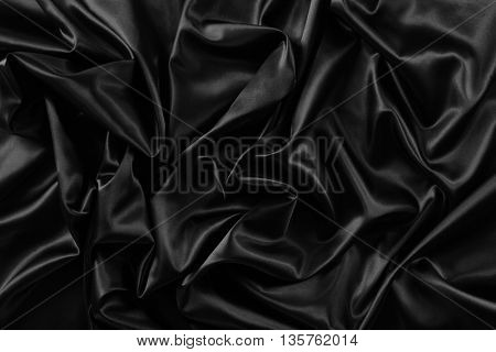 Closeup of rippled black silk fabric