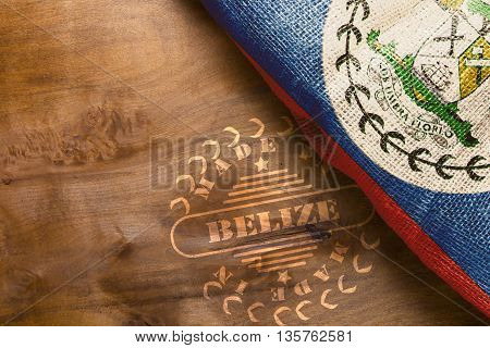 The national flag of Belize and imprint on a wooden surface Made in Belize