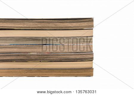Many books stacked on a white background