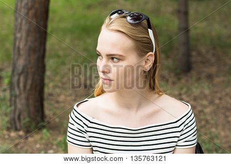 Portrait Of A Pensive Young Woman Looking Away