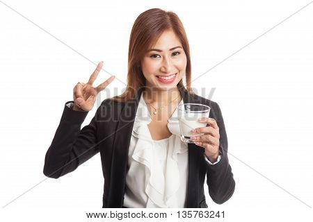 Healthy Asian Woman Drinking A Glass Of Milk Show Victory Sign